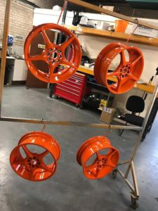 4 refurbished alloy wheels with new paint job which is orange