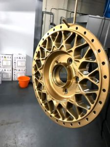 Refurbished alloy wheel with new colour that is gold
