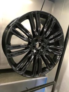 refurbished alloy wheel that has had a new paint job which is black
