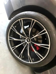 Repaired dented alloy wheel after